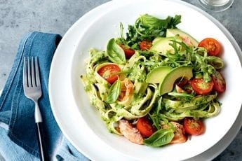 Avocado pesto pasta with hot-smoked salmon